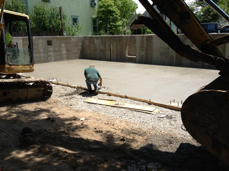 pouring concrete floor of garage athens brick properties llc